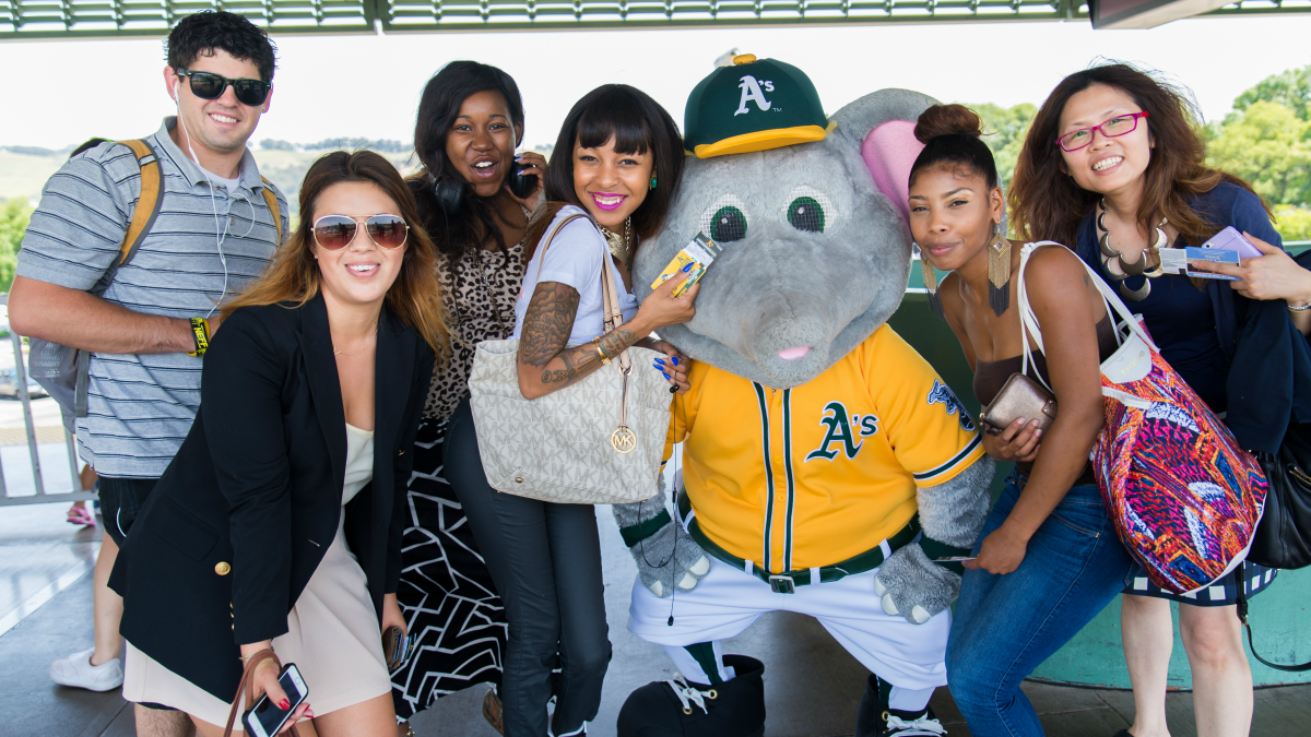 BART riders take a picture with Stomper